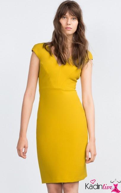 841e5ae70b85d Sarı tonlu tek renk elbise modeli farklı kesim ve tasarımı ile dikkat çeken  şık elbise modelleri arasında arka kısmı ve ön kısmı V yaka asimetrik  kesimli ...